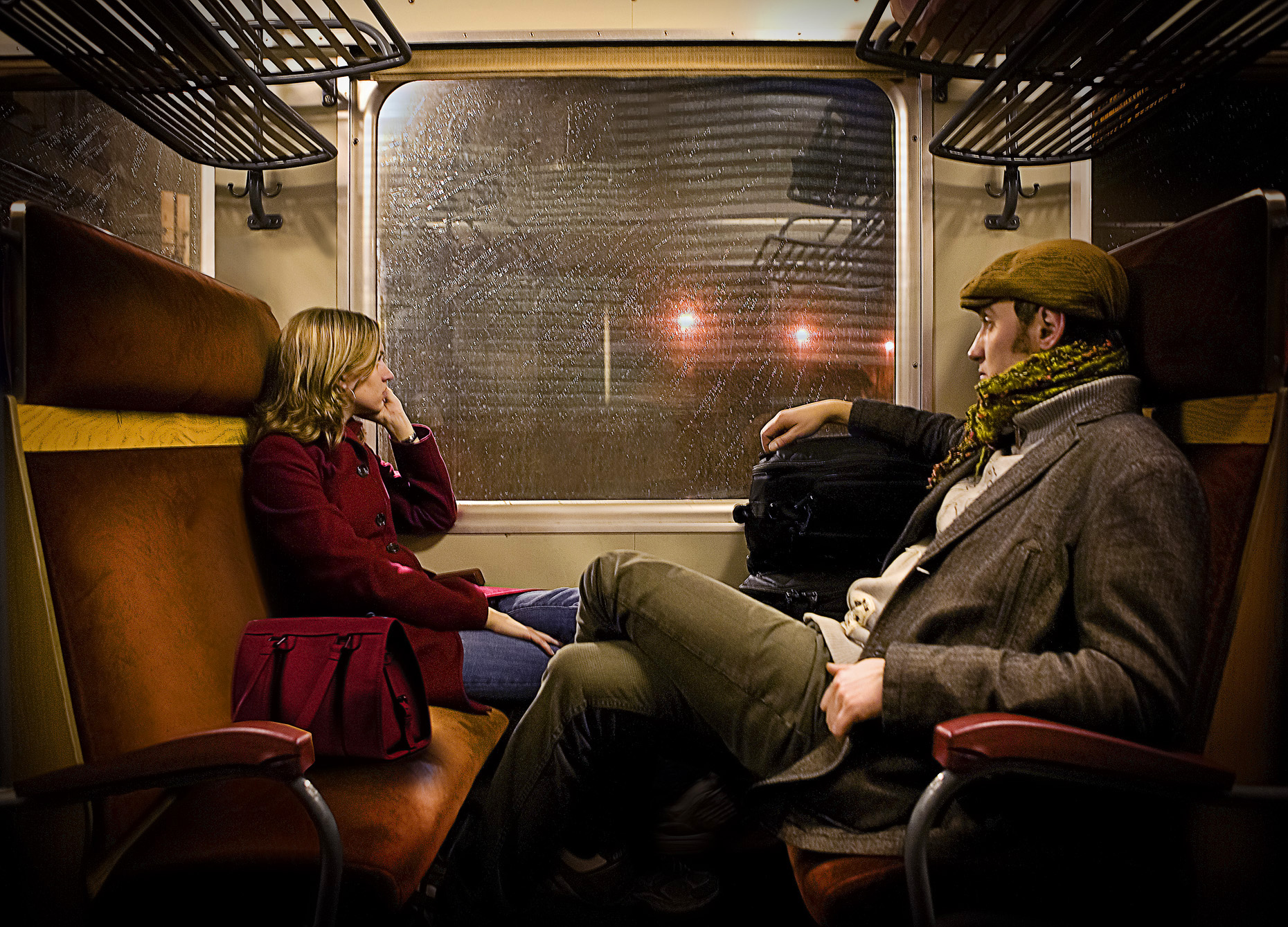 Assurant couple on train, Andy Goodwin Photography